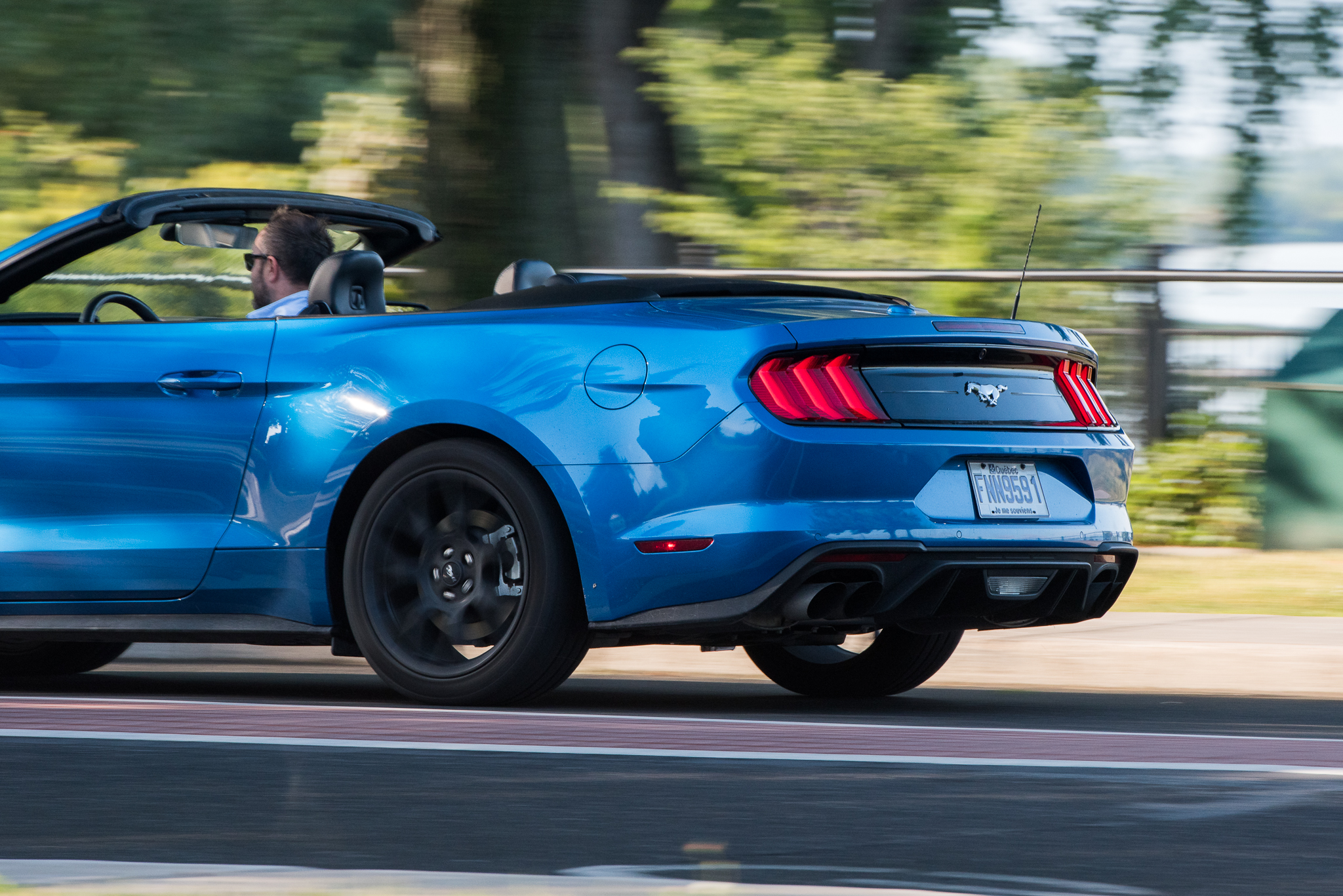 ford mustang ecoboost convertible driving rear side claveys corner